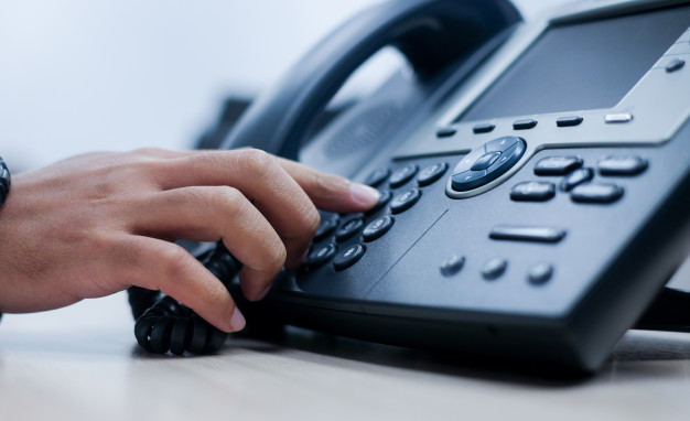 man-hand-point-to-press-button-number-on-telephone-office-desk_42708-288